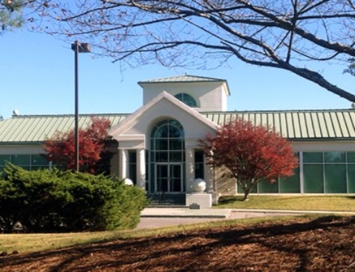 Real estate firm acquires Greystone office building